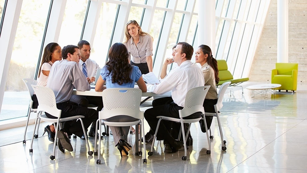 WEB - Business People Having Board Meeting In Office-885557-edited