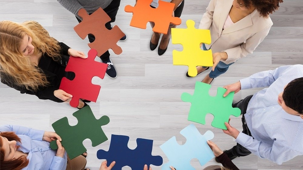WEB Team with colourful jigsaw-723259-edited
