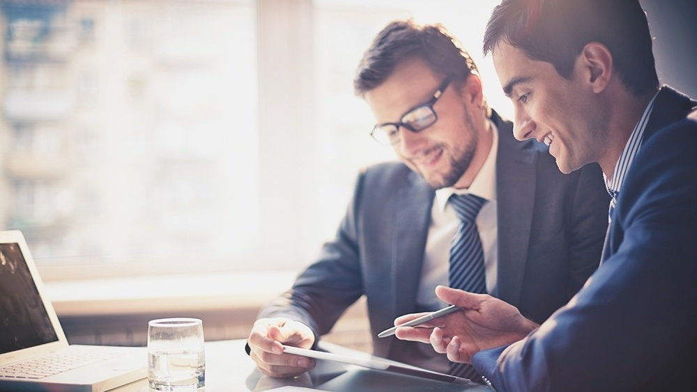 WEB - Two Businessmen Using a Tablet At a Meeting-159069-edited