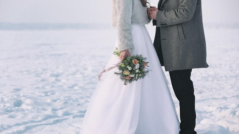 WEB - Winter Wedding Couple Snow Flowers.jpeg-621285-edited