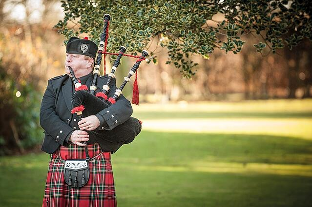 WEB - Woodside Wedding - Garden Bagpiper.jpg